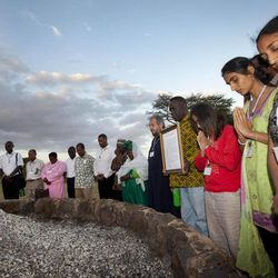 In this photo taken Thursday, Sept. 20, 2012, Preetika Bhanderi of the Hindu Council of Africa, 2nd right, leads a prayer by religious leaders of different faiths around a pile of charred elephant ivory at a site in Nairobi National Park where Kenyan officials burned hundreds of ivory tusks in 1989 to draw attention to the slaughter of elephants, in Nairobi, Kenya. Seeing a dire situation grow worse, the animal conservation group the World Wildlife Fund (WWF) enlisted religious leaders on Thursday, Sept. 20, 2012 in the fight to end the slaughter of Africa's elephants and rhinos by poachers, hoping that religion can help save some of the world's most majestic animals.