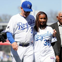 Manager Ned Yost #3 of the Kansas City Royals walks off the field with his arm around Marisol Hernandez, mother of deceased pitcher Yordano Ventura #30, as Ventura's grandfather Raul Hernandez follows prior to the Royals 2017 home opener against the Oakland Athletics at Kauffman Stadium on April 10, 2017 in Kansas City, Missouri. Marisol Hernandez threw out the ceremonial first pitch.