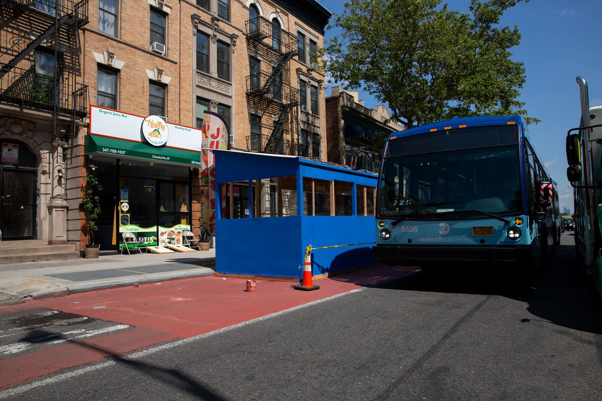 An express bus was forced to squeeze between a Crown Heights restaurant shed built in the bus lane on Nostrand Avenue and deliver truck, June 15, 2021.