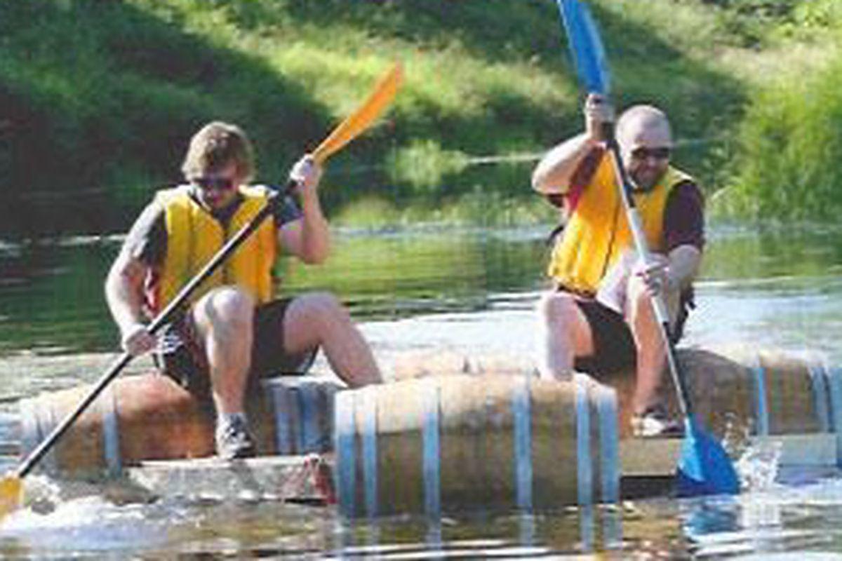 """Barrel Boat"" on the Sammamish Slough during the 2014 Woodinville Winemaker, Brewer, and Distiller Triatholon"
