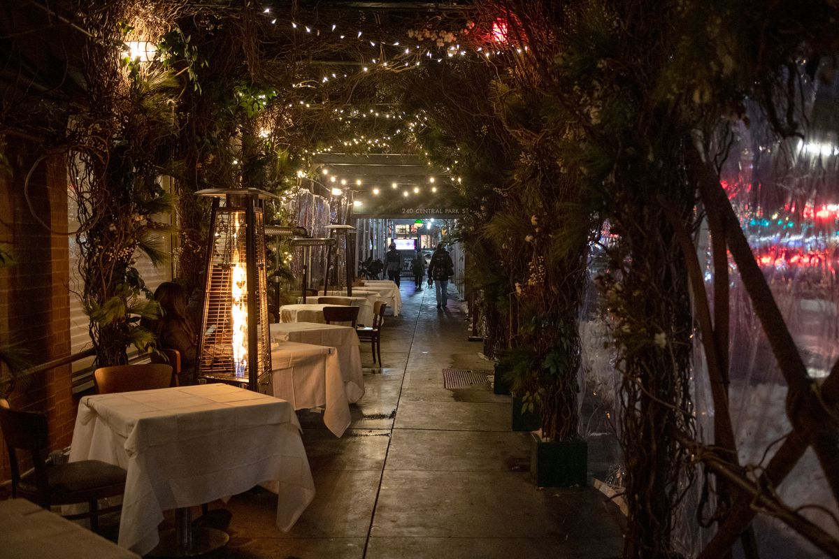 An outdoor heater is lit near a row of outdoor tables at Marea on December 19, 2020 in New York City.