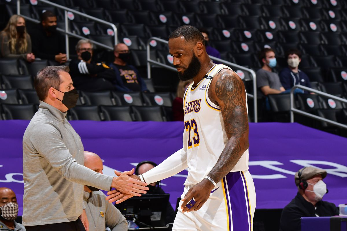 LeBron James #23 of the Los Angeles Lakers high fives Head Coach Frank Vogel of the Los Angeles Lakers on May 2, 2021 at STAPLES Center in Los Angeles, California.