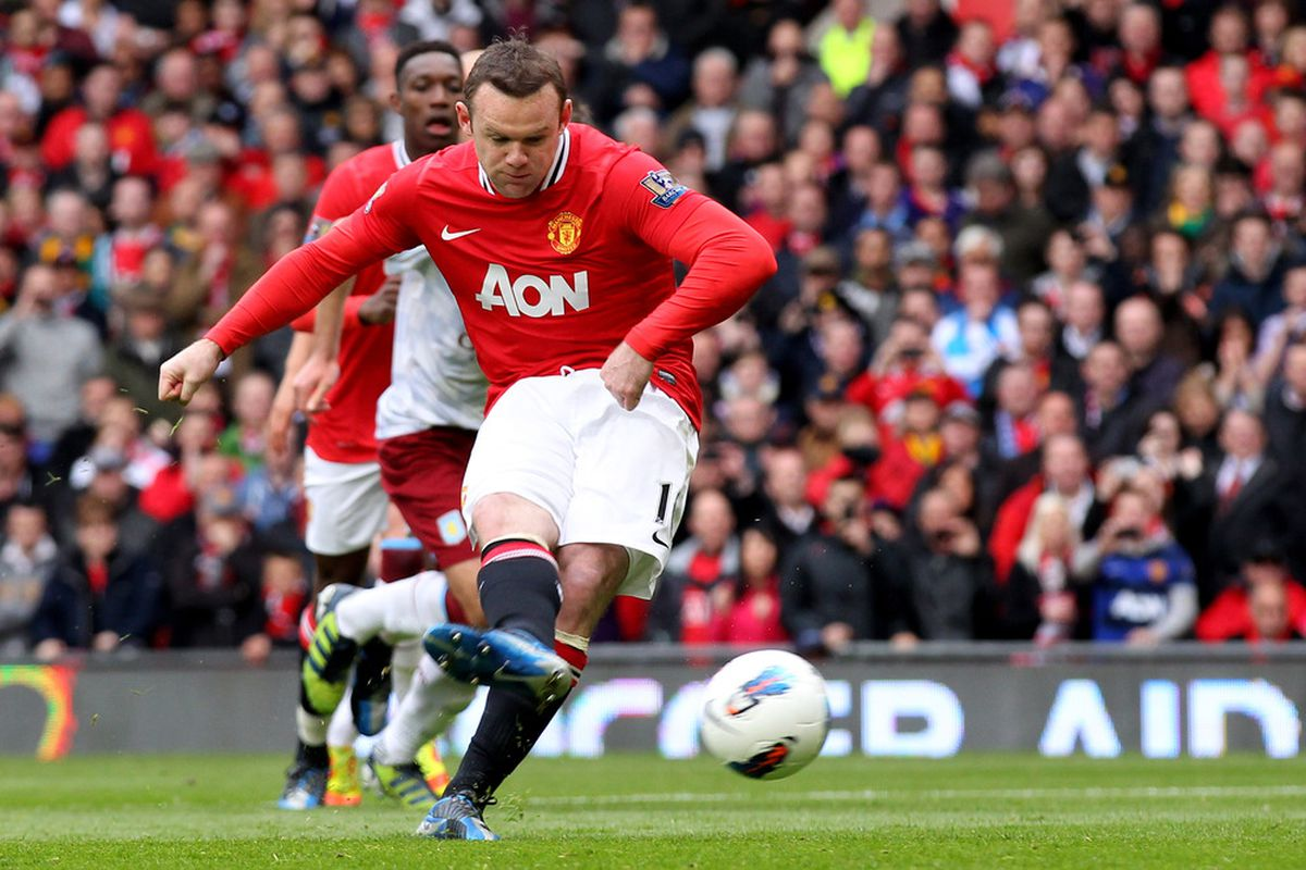 Rooney tucked home the Peno. But was it or wasn't it ?(Photo by Alex Livesey/Getty Images)