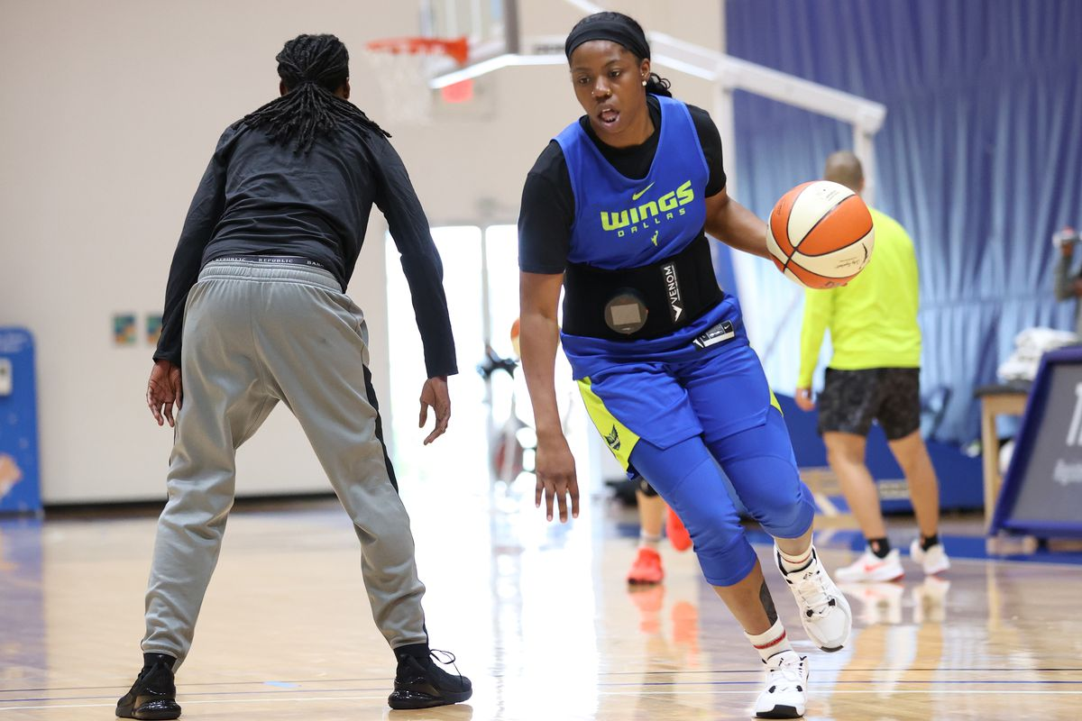 Arike Ogunbowale of the Dallas Wings laces up before practice on July 22, 2020 at IMG Academy in Bradenton, Florida.