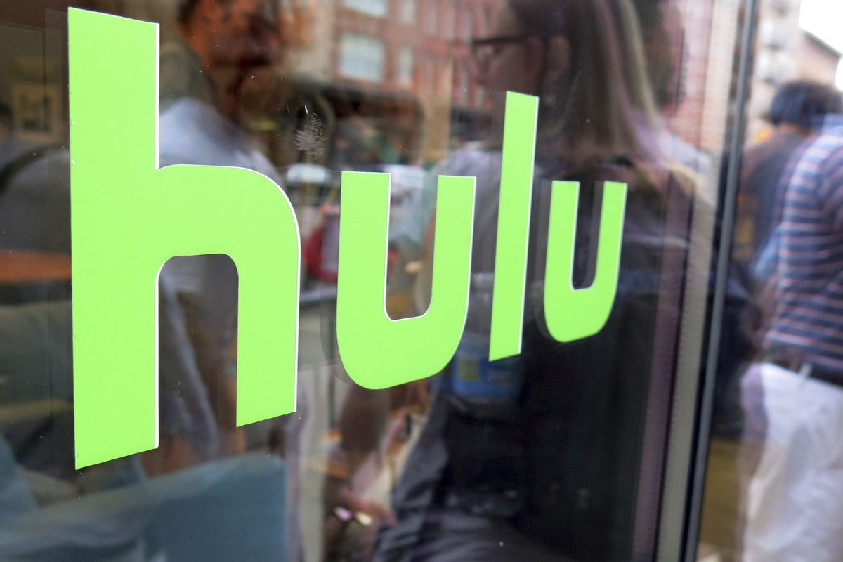 FILE - This June 27, 2015, file photo, shows the Hulu logo on a window at the Milk Studios space in New York. To get a full slate of programming, TV watchers may soon have to subscribe to several services instead of just one or two. Among those options wi