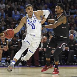 FILE - In this March 19, 2017, file photo, Duke's Jayson Tatum, left, drives past South Carolina's Chris Silva during the first half in a second-round game of the NCAA men's college basketball tournament, in Greenville, S.C. Tatum spent one season at Duke and is expected to be a top-five pick in Thursday's NBA draft.