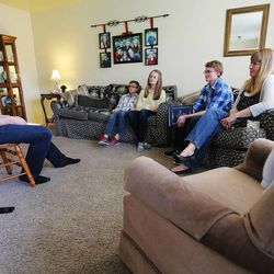 Dave Evans givers a lesson as he and his wife Becky enjoy family home evening Monday, May 11, 2015, together with three of their children in Murray.