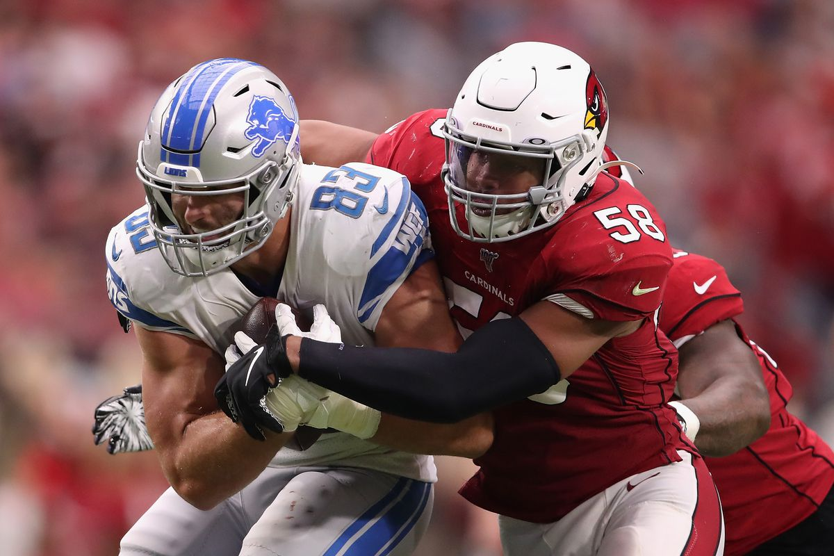 Tight end Jesse James of the Detroit Lions makes a reception against middle linebacker Jordan Hicks of the Arizona Cardinals during the second half of the NFL game at State Farm Stadium on September 08, 2019 in Glendale, Arizona.