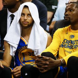 Golden State Warriors guard Stephen Curry #30 and forward Kevin Durant #35 look on during game four of the Western Conference Semifinal at Vivant Smart Home Arena in Salt Lake City on Monday, May 8, 2017.
