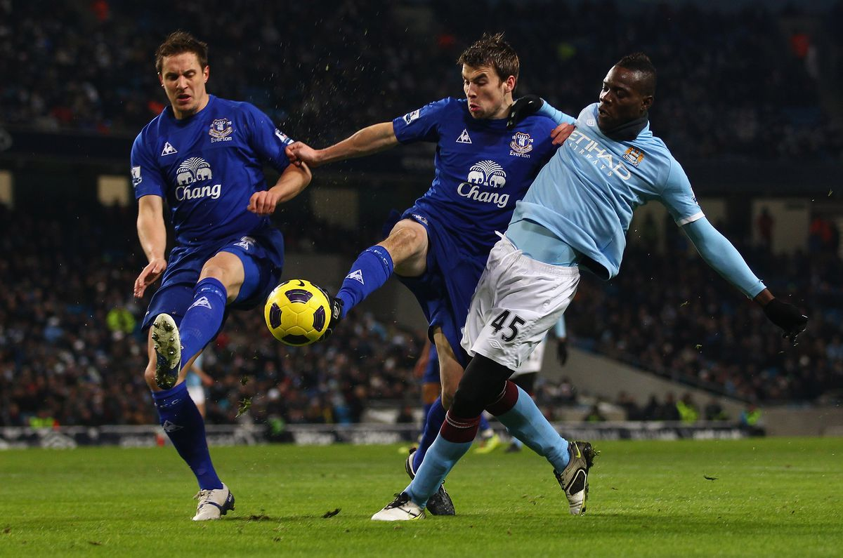 Mario Balotelli of Manchester City in action with Seamus Coleman and Phil Jagielka - Manchester City v Everton - Premier League
