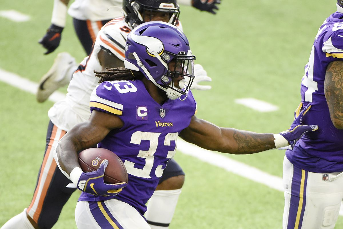 Dalvin Cook #33 of the Minnesota Vikings runs with the ball during the first half against the Chicago Bears at U.S. Bank Stadium on December 20, 2020 in Minneapolis, Minnesota.