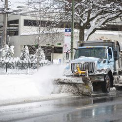 A plow clears snow on West Addison Street in Lake View.
