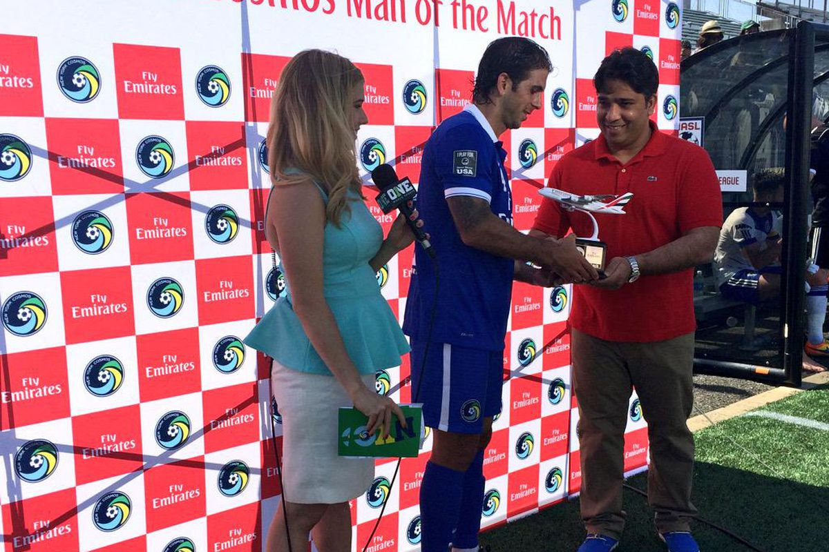 Carlos Mendes accepts the honors of Man of the Match after a two goal performance