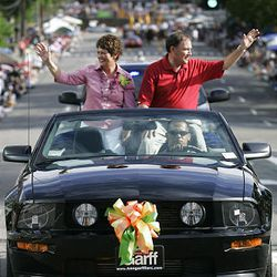 Jeanette and Gary Herbert wave to the crowds watching the Days of '47 parade on July 24 in Salt Lake City.