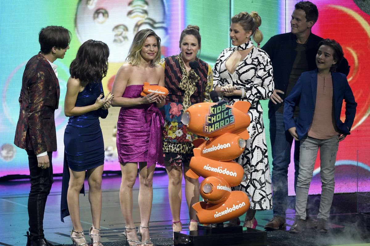 """The cast of """"Fuller House"""" accepts the award for favorite funny TV show at the Nickelodeon Kids' Choice Awards on Saturday, March 23, 2019, at the Galen Center in Los Angeles."""