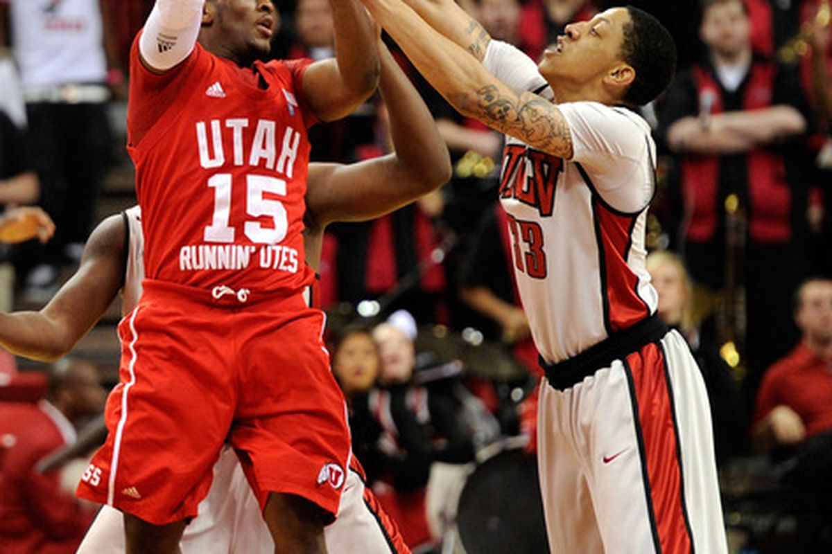 LAS VEGAS NV - FEBRUARY 02:  Josh Watkins #15 of the Utah Utes passes over Tre'Von Willis #33 of the UNLV Rebels during their game at the Thomas & Mack Center February 2 2011 in Las Vegas Nevada. UNLV won 67-54.  (Photo by Ethan Miller/Getty Images)