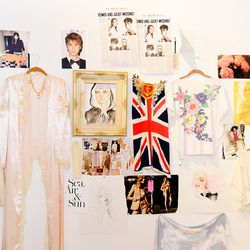 We spy Bieber and Britney on Kim's inspiration wall in her office.