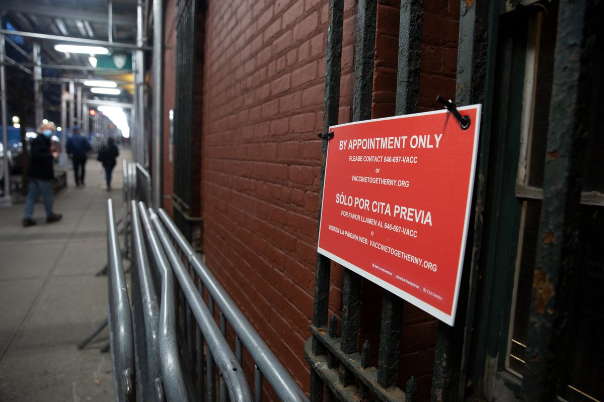 A sign dissuades people from showing up without a vaccine appointment at the Washington Heights armory.