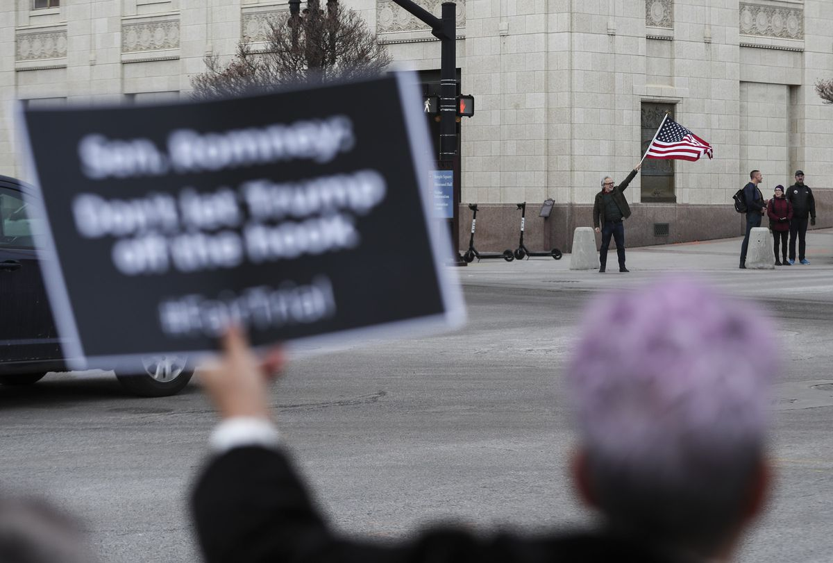 Samir Selmanozic, with Vote Common Good, waves an American flag as he and others rally at the Wallace G. Bennett Federal Building in Salt Lake City on Thursday, Jan. 16, 2020, for a full and fair impeachment trial of President Donald Trump.