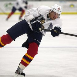 Florida Panthers hockey player Tomas Kopecky, of Slovakia, shoots the puck during an informal skate Friday, Sept. 14,2012 in Coral Springs, Fla. With a lockout drawing ever closer, the NHL and the players' union are in touch with each other after a day of internal meetings. But no new negotiating sessions are scheduled for Friday, one day before Commissioner Gary Bettman has said he will lock out the players. This would be the NHL's fourth work stoppage since 1992.
