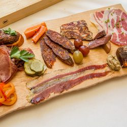 Emeril's Delmonico does old-school traditional salumi with some Creole revamps.