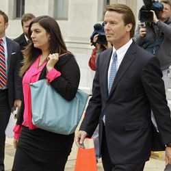 Former presidential candidate and U.S. Sen. John Edwards, right, leaves a federal court with his daughter Cate, left, in Greensboro, N.C., Monday, April 23, 2012. A former aide to Edwards has taken the witness stand in his criminal trial to testify about his role in allegedly violating campaign finance laws to cover up an extramarital affair.