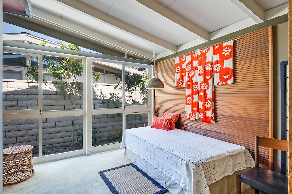 Guest room with glass walls