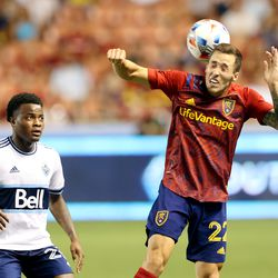 Real Salt Lake defender Aaron Herrera (22) heads the ball with Vancouver Whitecaps defender Javain Brown (23) watching as Real Salt Lake and Vancouver FC play at Rio Tinto Stadium in Sandy on Wednesday, July 7, 2021. RSL won 4-0.