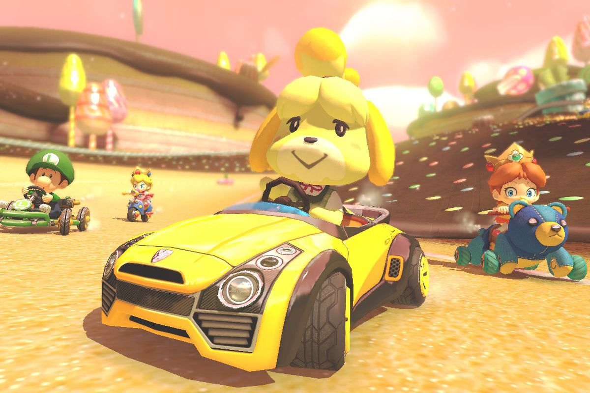 Isabelle driving a car in Mario Kart 8 for Switch.