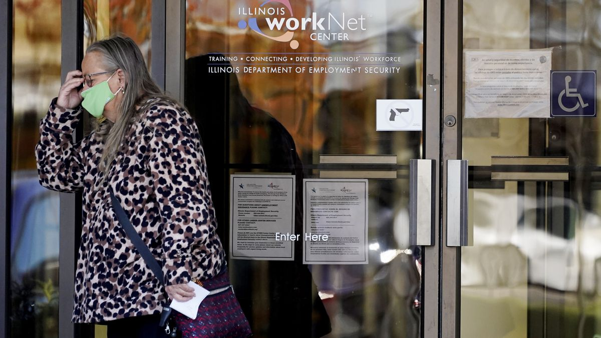 A woman in a mask leaving an employment office.
