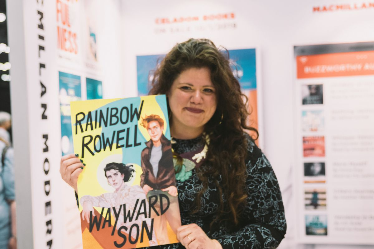 Rowell poses with a poster for Wayward Son