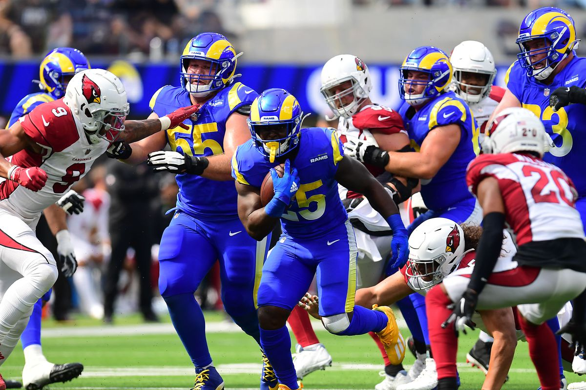 Los Angeles Rams running back Sony Michel (25) runs the ball against the Arizona Cardinals during the first half at SoFi Stadium.