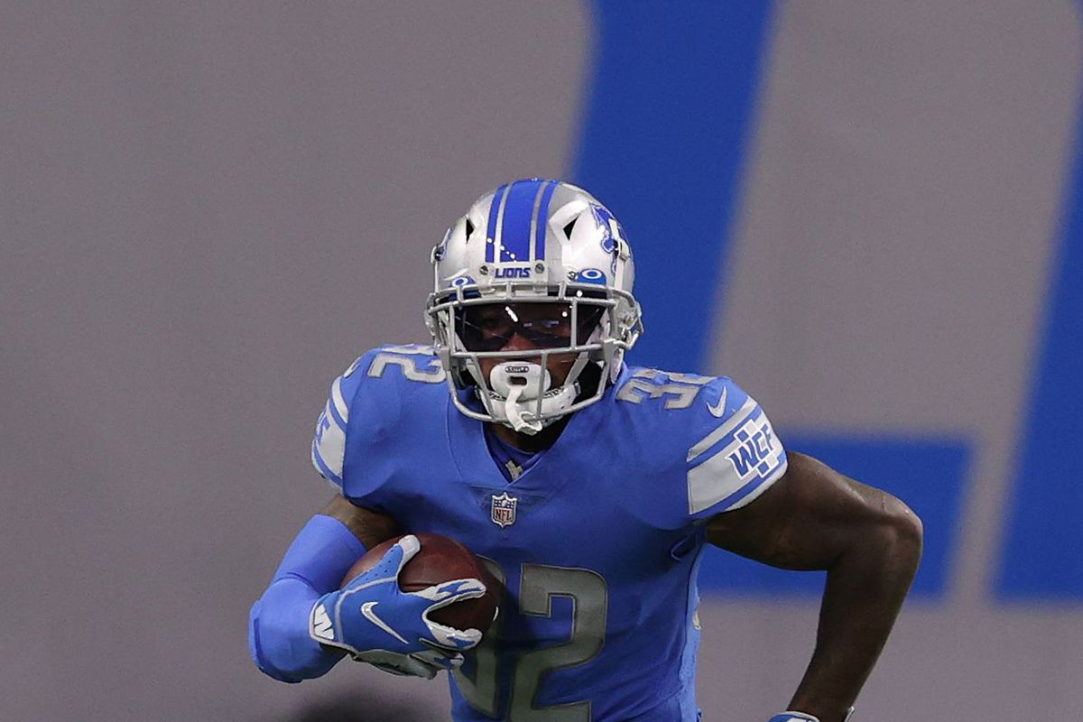 D'Andre Swift #32 of the Detroit Lions looks for yards during a run against the Washington Football Team at Ford Field on November 15, 2020 in Detroit, Michigan.