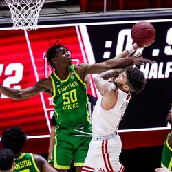 Utah Utes forward Timmy Allen (1) goes to the hoop against Oregon Ducks forward Eric Williams Jr. (50) during the game at the Huntsman Center in Salt Lake City on Saturday, Jan. 9, 2021.