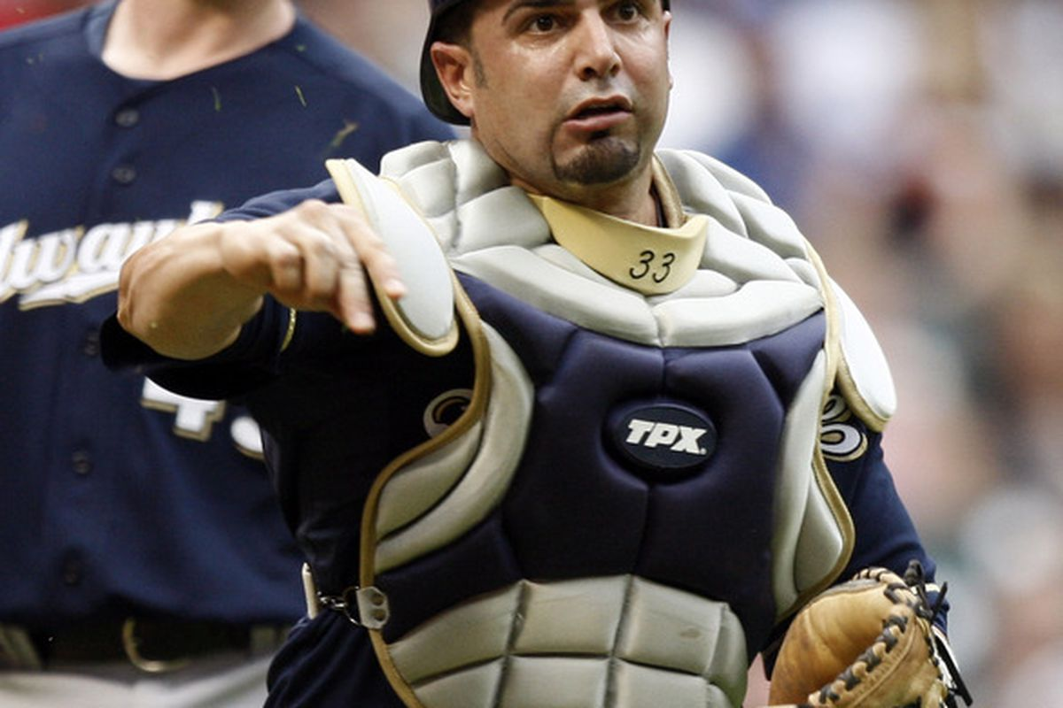 HOUSTON - APRIL 30:  Catcher Wil Nieves #33 of the Milwaukee Brewers throws out Wandy Rodriguez #51 of the Houston Astros on a bunt in the second inning at Minute Maid Park on April 30, 2011 in Houston, Texas.  (Photo by Bob Levey/Getty Images)