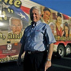 Bobby Welch, president of the Southern Baptist Convention, poses beside his tour bus in front of the First Baptist Church of West Valley City, while on his 50-state church tour.