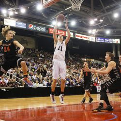 Highland's Connor Harding shoots as Post Falls' Zach Hillman, left, watches during the second half of the Class 5A state championship high school basketball game in Nampa, Idaho, on Saturday, March 7, 2015. Post Falls won 67-62 in overtime.
