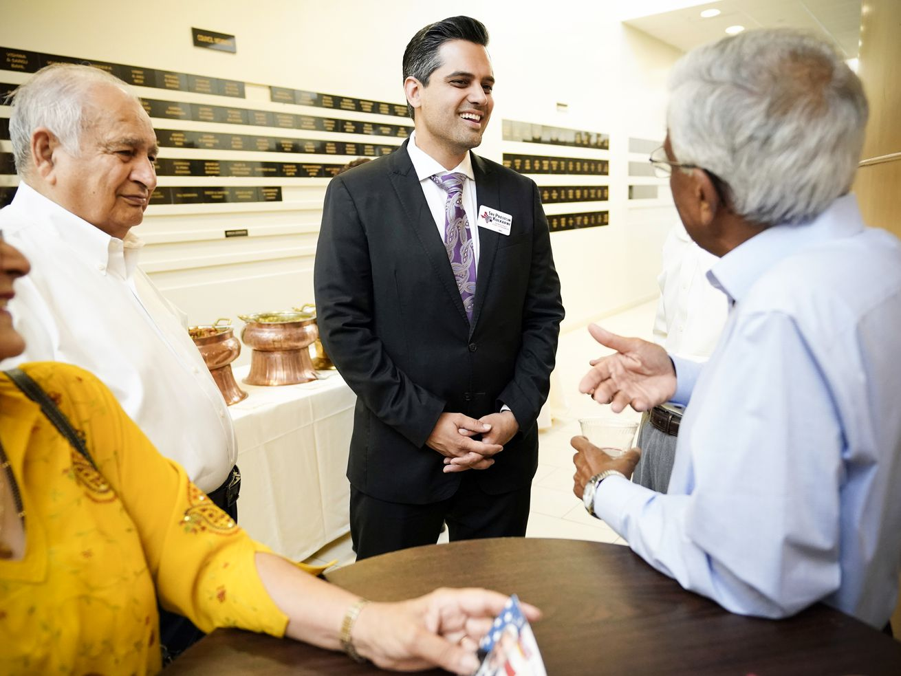 Democrat Congressional candidate Sri Kulkarni (center) listens to supporters at a fundraiser in Houston, Texas, July 29, 2018.