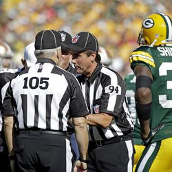 Green Bay Packers' Sam Shields (37) watches as referees talk about a play during the first half of an NFL football game against the San Francisco 49ers Sunday, Sept. 9, 2012, in Green Bay, Wis.