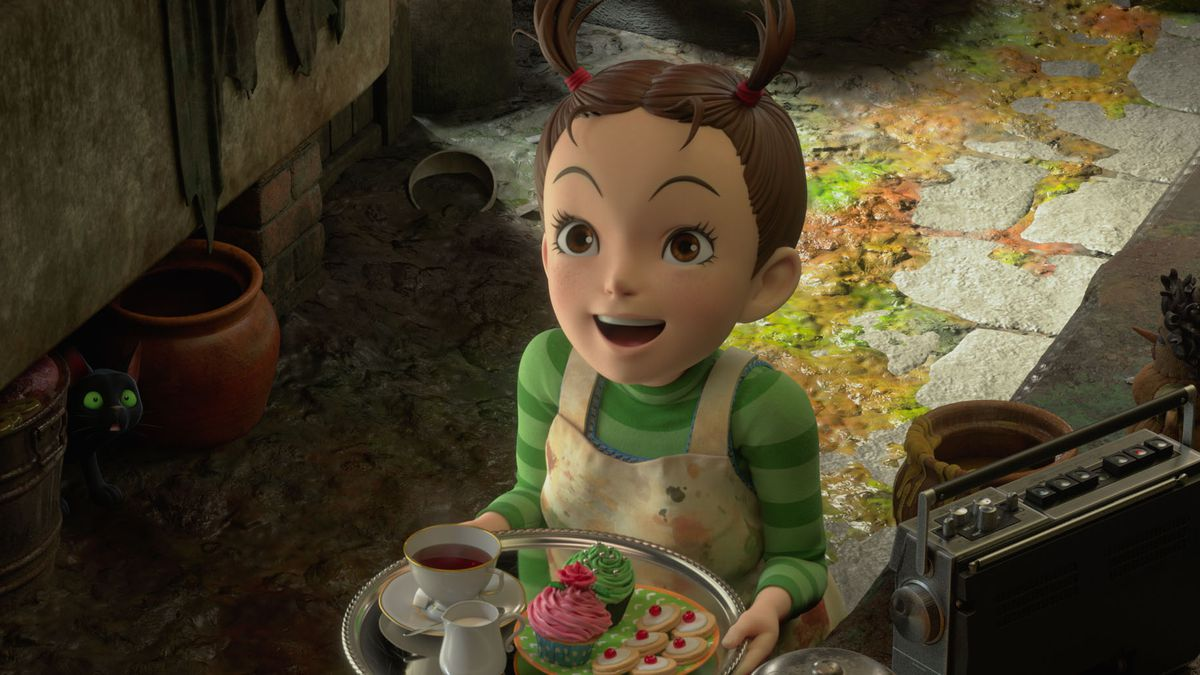 Earwig holds a tray of tea and cookies in Earwig and the Witch