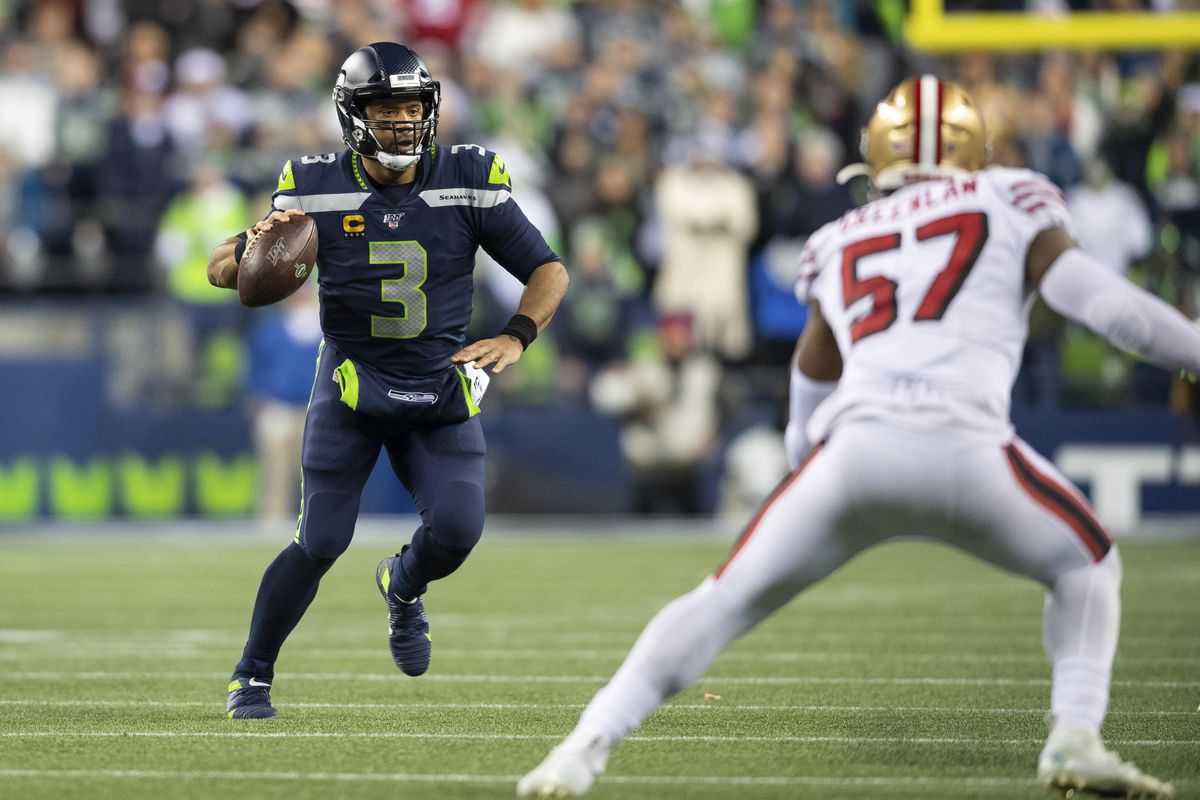 Seattle Seahawks quarterback Russell Wilson looks for an open receiver during the second half against the San Francisco 49ers at CenturyLink Field. San Francisco defeated Seattle 26-21.