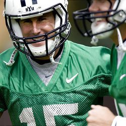 BYU quarterback Max Hall is all smiles at practice Saturday. He hopes to keep the Cougars' tradition of success by senior quarterbacks rolling.