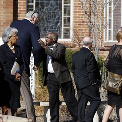 People arrive at Wasatch Presbyterian Church in Salt Lake City, Monday, March 9, 2015 for the funeral service for Deedee Corradini. At center are Mark Eaton and Rev. France A. Davis.