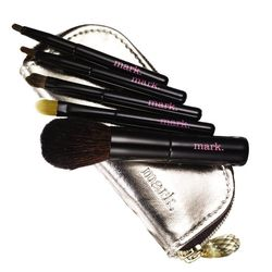 """Mark. Toolin Around Mini Brush Kit, <a href=""""http://www.meetmark.com/shop/product.aspx?pf_id=48036&dept=new"""">$16</a>. """"Aside from being impossibly adorable, this fivesome from Mark. is perfectly practical! With an eyeshadow, eyeliner, concealer, lip, and"""