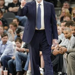 San Antonio Spurs head coach Gregg Popovich signals to his players during the first half of an NBA basketball game against the Utah Jazz, Friday, March 23, 2018, in San Antonio. San Antonio won 124-120 in overtime. (AP Photo/Darren Abate)