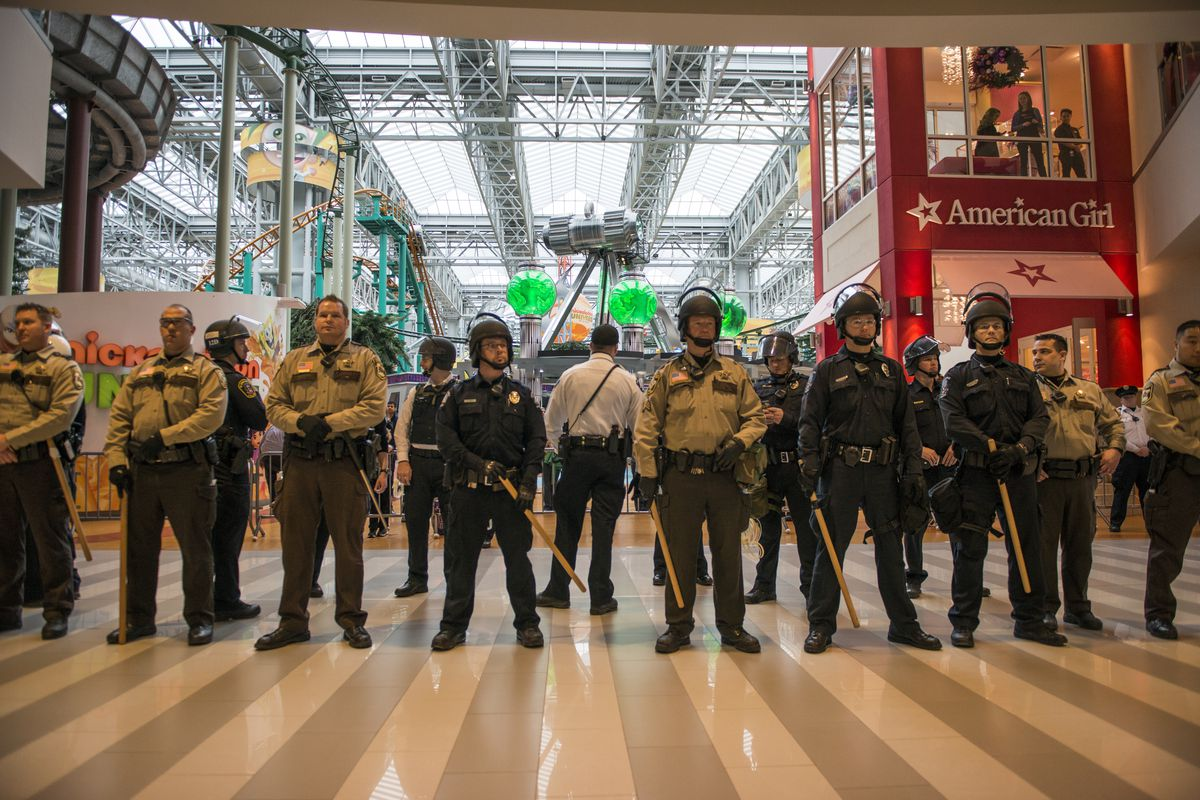 Police prepare to clear the Mall of America of Black Lives Matters protesters, in Dec. 2015. A bill pending in Minnesota would charge protesters who broke the law for the costs of policing.