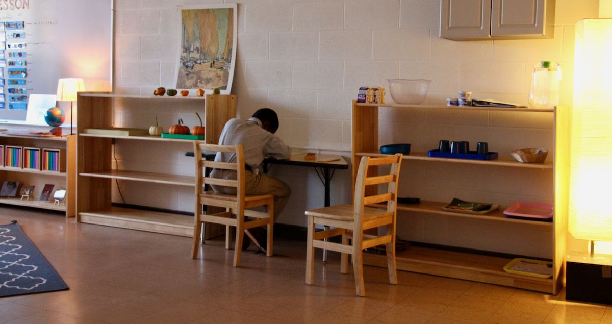 Many Libertas classrooms with special education students feature soft light and classical music playing while students work.
