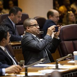 Ald. Michael Scott Jr. (24th) takes a photo during Mayor Lori Lightfoot's first Chicago City Council meeting at City Hall, Wednesday, May 29, 2019.