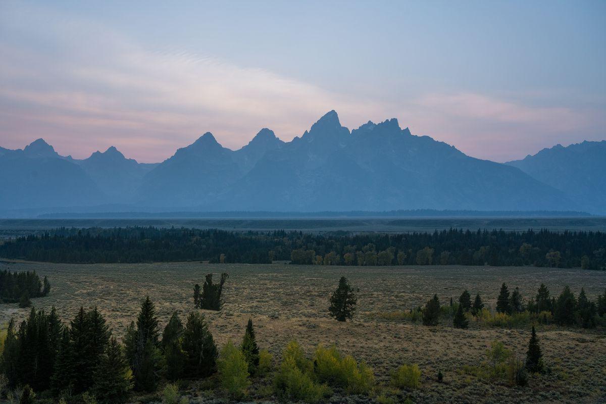 A pastel sunset over the Teton Mountain Range. Grand Teton National Park.