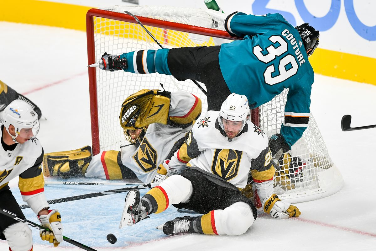 The puck stays out while San Jose Sharks center Logan Couture (39) collides with Vegas Golden Knights goaltender Marc-Andre Fleury (29) and defenseman Alec Martinez (23) in the third period at SAP Center at San Jose. Mandatory Credit: Chris Brown